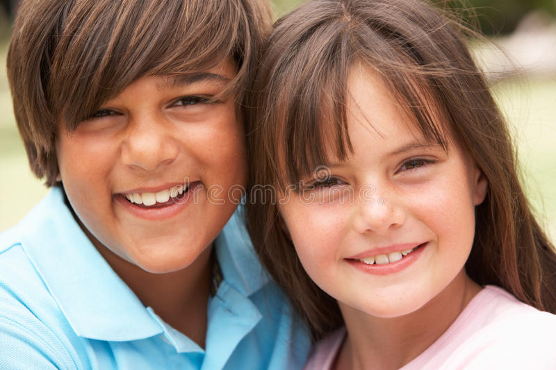 Two Children In Park Giving Each Other Hug royalty free stock photography