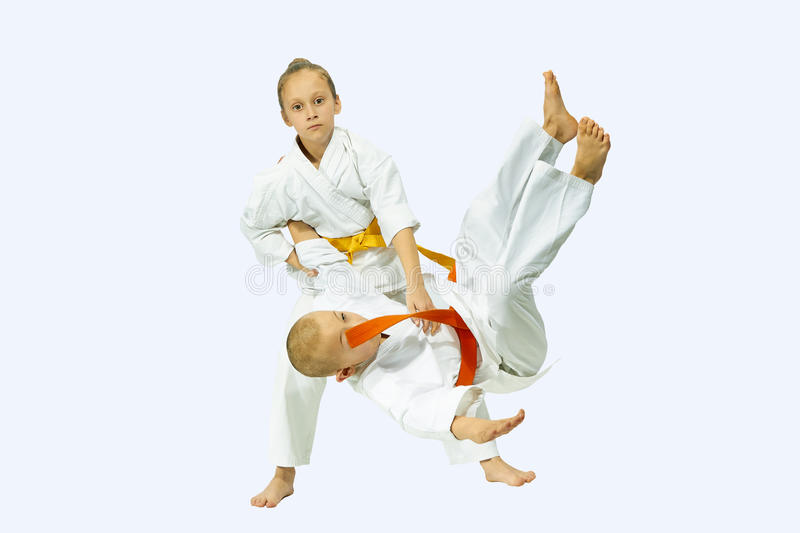 Two children performs judo throws stock images