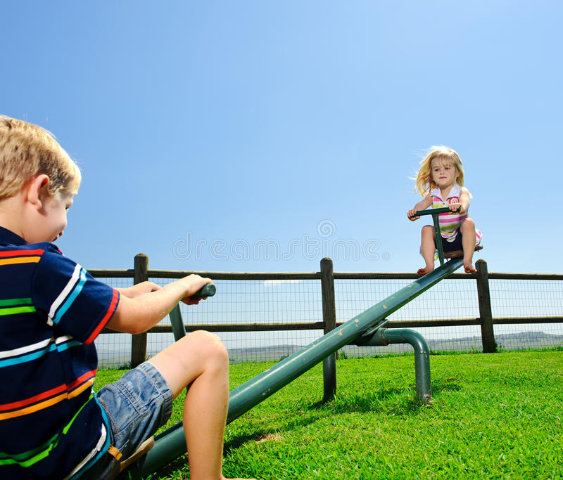 Two Children In The Playground Stock Photo