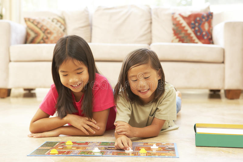 Two Children Playing Board Game At Home royalty free stock image