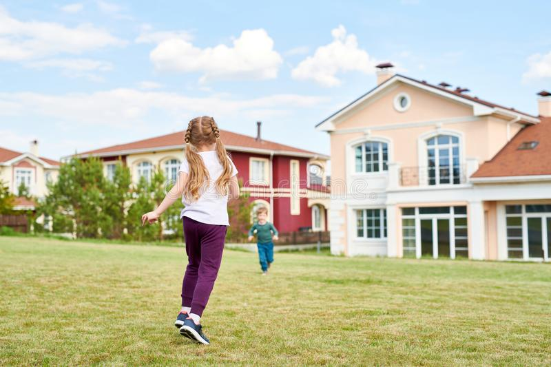 Two of Children Playing in Front Yard stock images