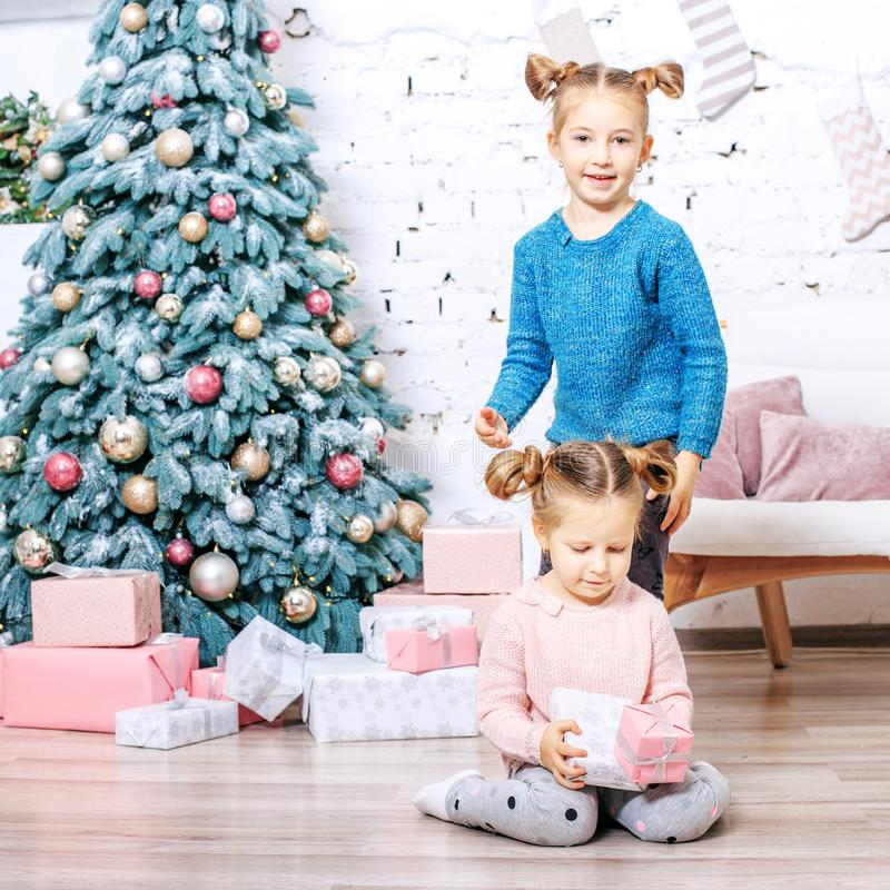 Two children are playing in the room. Concept New Year, Merry Ch. Two children are playing in the room. Square. Concept New Year, Merry Christmas, holiday royalty free stock photo