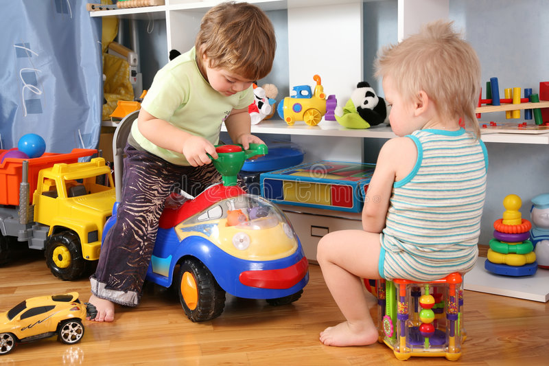 Two children in playroom stock images