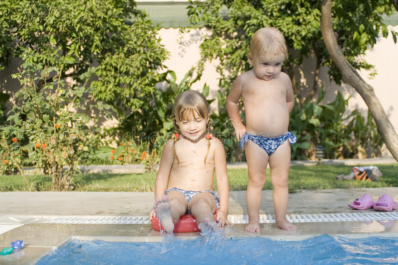 Two children in a pool royalty free stock photo