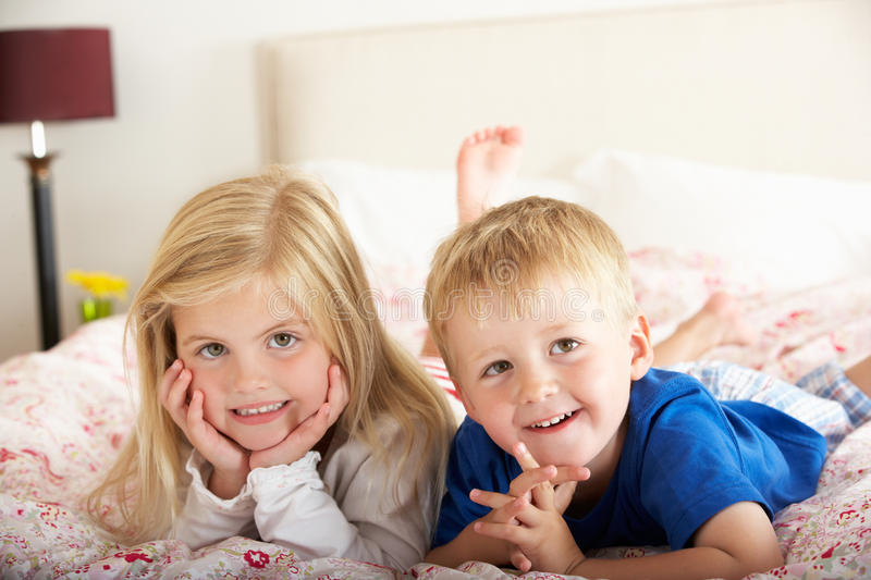 Download Two Children Relaxing On Bed Stock Image - Image: 26615943