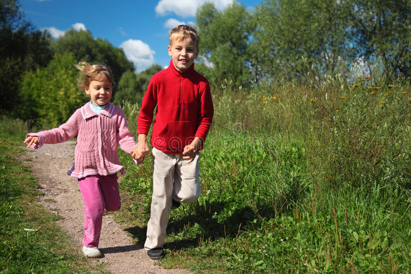 Two Children Run On Path In Summer Stock Image