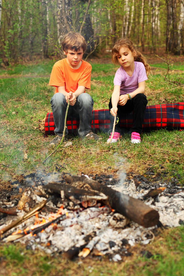 Free Two Children Sit Around Campfire Stock Photography - 23997242