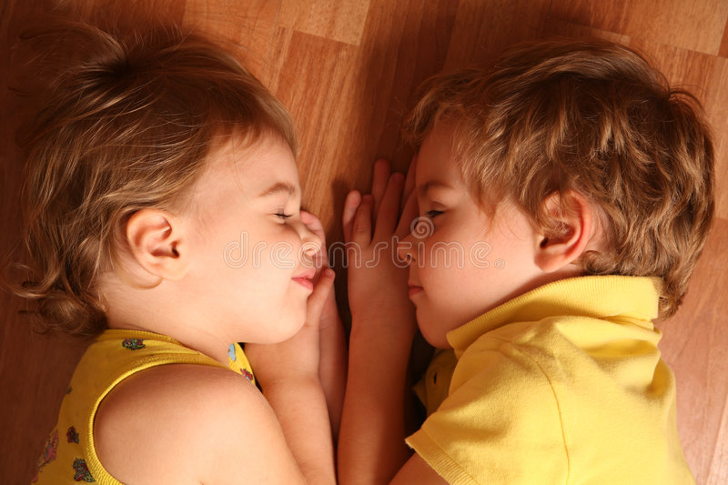 Download Two Children Sleep On Floor Stock Photo - Image of cute, family: 3907778