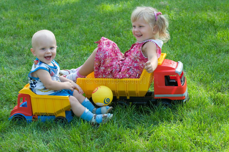 Two children on trucks
