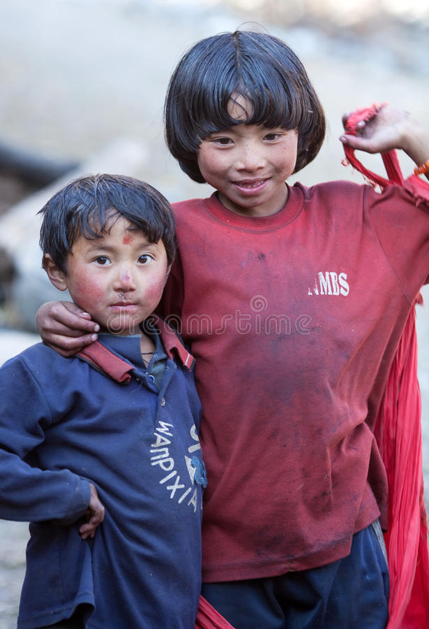 Two children from village of tibetan refuges stock photos
