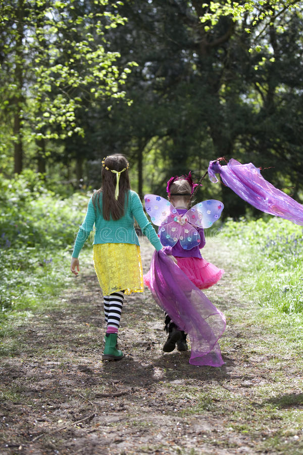 Two children walking along a woodland path stock photo