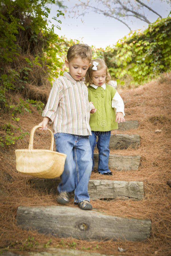 Download Two Children Walking Down Wood Steps With Basket Stock Image - Image: 27115139