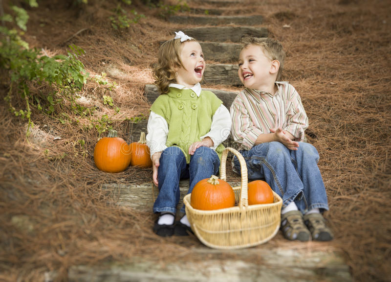 Two Children on Wood Steps with Pumpkins Whisperi