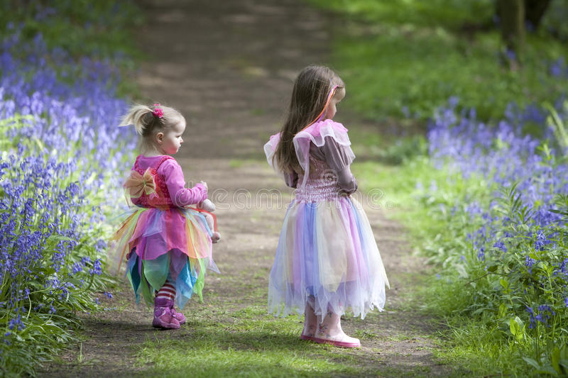 Two children on a woodland walk in spring royalty free stock photography