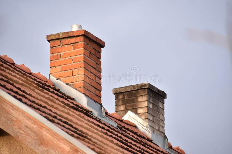 Two chimneys on the house royalty free stock photos