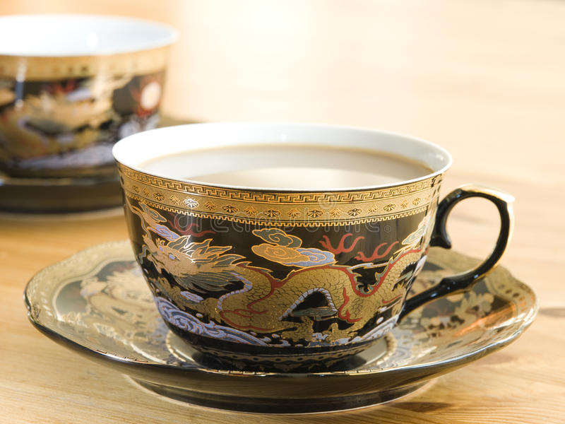 Two china porcelain cups of coffee. stock photography