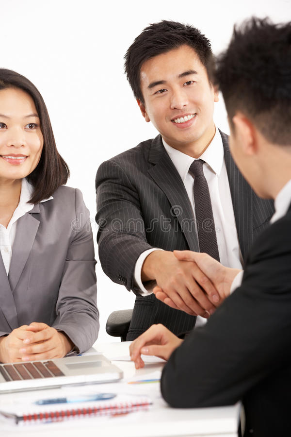 Download Two Chinese Businessmen Shaking Hands During Meet Stock Photo - Image: 26099986