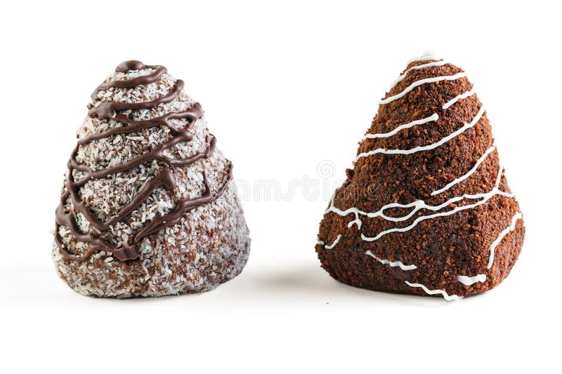 Two chocolate brownies . One is poured with white chocolate and sprinkled with cocoa, the second is poured with dark chocolate and royalty free stock photography