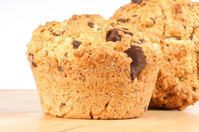 Two chocolate chips and pine nuts muffins royalty free stock photos