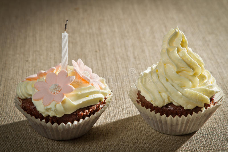 Two chocolate muffin with candle stock photos