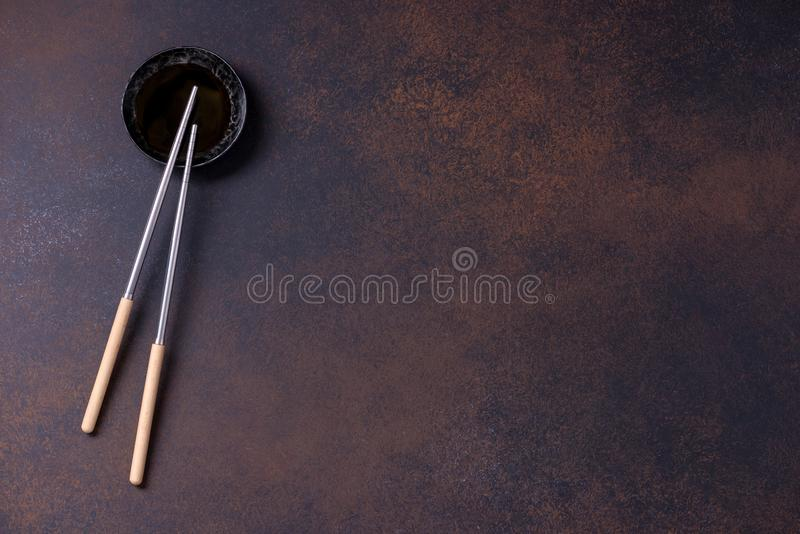 Two chopsticks and sauce for asia food stock image