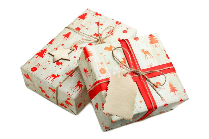 Two christmas gifts. In beautiful packaging isolated on white royalty free stock photography