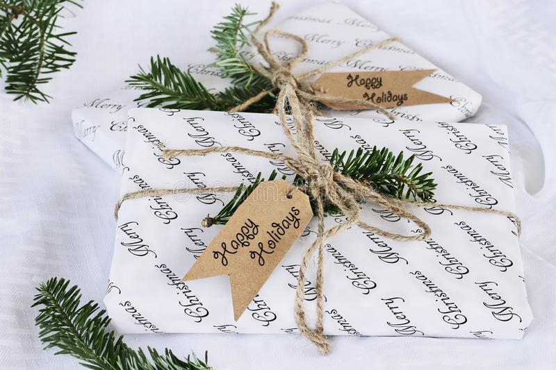 Two Christmas Gifts with Happy Holidays Tags stock photos