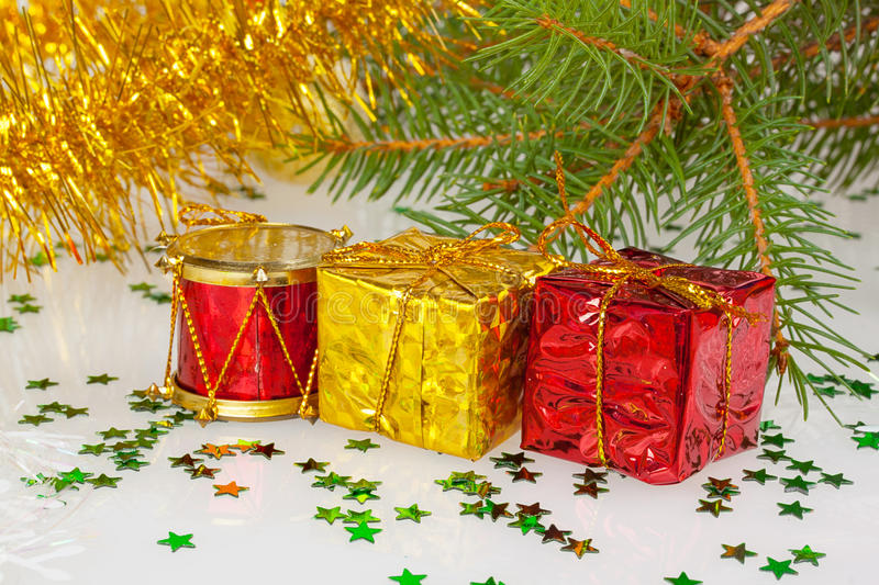 Two Christmas gifts under the Christmas tree. With red drum stock image