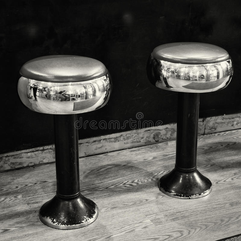 Two chrome and black stools royalty free stock photography