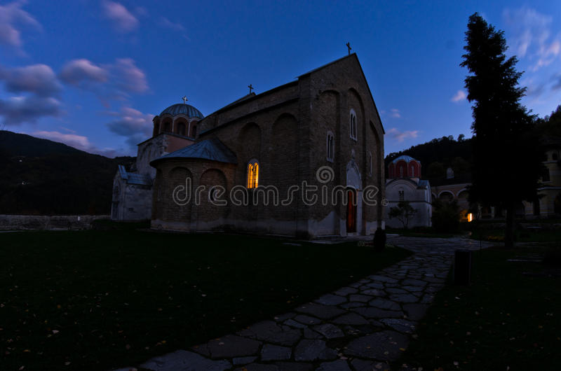 Two churches inside Studenica monastery during evening prayer. Two churches inside 12.century Studenica monastery during evening prayer, UNESCO world heritage stock image