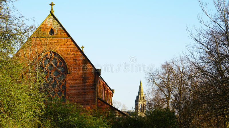 Two churches. Two churches sunlit on a Spring day royalty free stock image