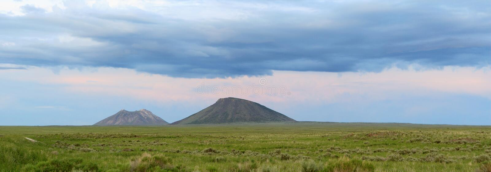 Two dormant shield volcano`s in the desert of south east Idaho. stock images