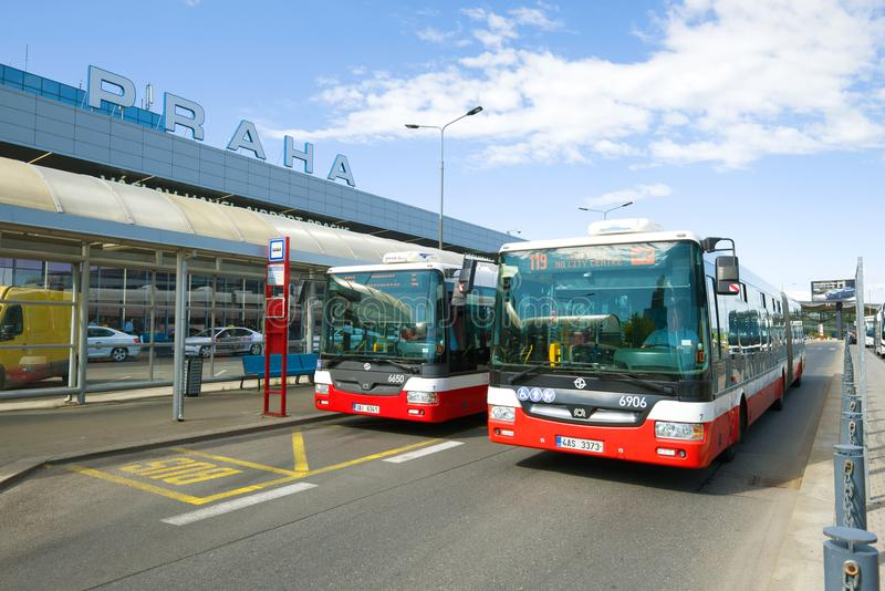 Two city buses at the bus stop near the Terminal 1 of the Vaclav Havel airport. Prague, Czech Republic. PRAGUE, CZECH REPUBLIC-APRIL 30, 2018: Two city buses at stock photos