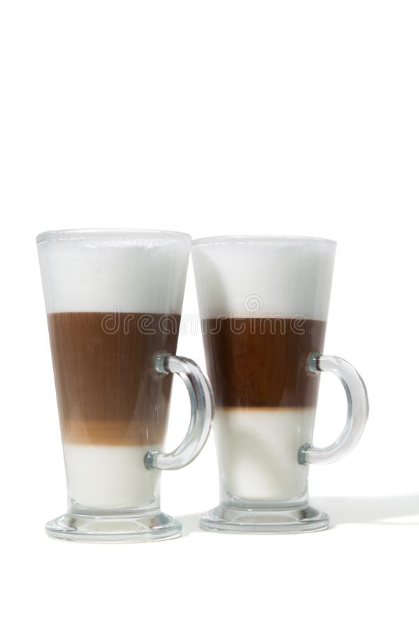 Two glasses of caffe with milk on white background stock photography