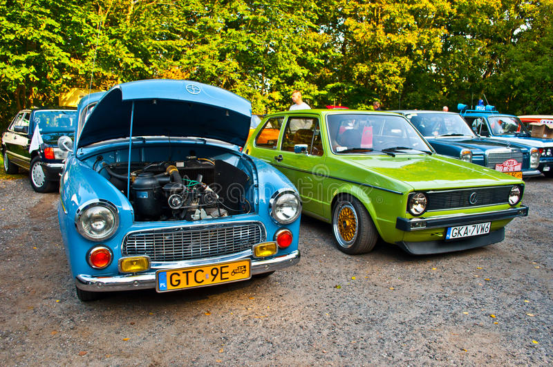 Two classic cars Syrena 105 and Volkswagen Golf I stock photography