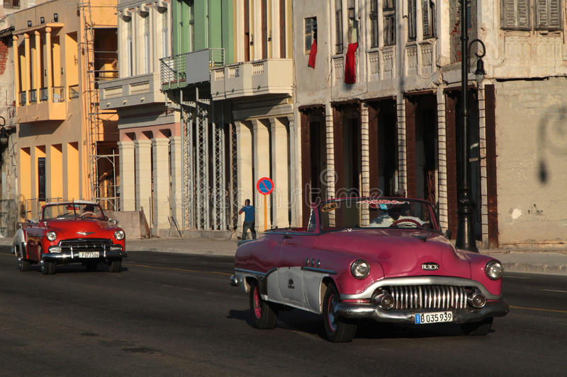 Two classic old American car on Malecon Blvd stock photography