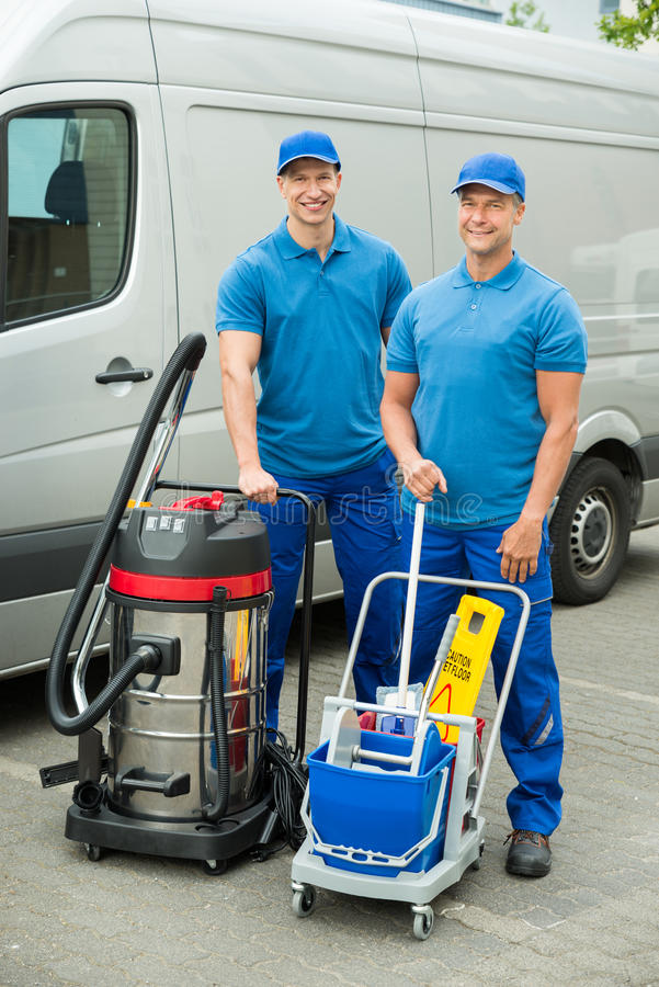 Free Two Cleaners Standing With Cleaning Equipments Stock Photography - 56852072