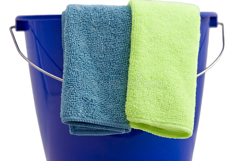 Two Cleaning microfiber cloths a blue bucket royalty free stock images