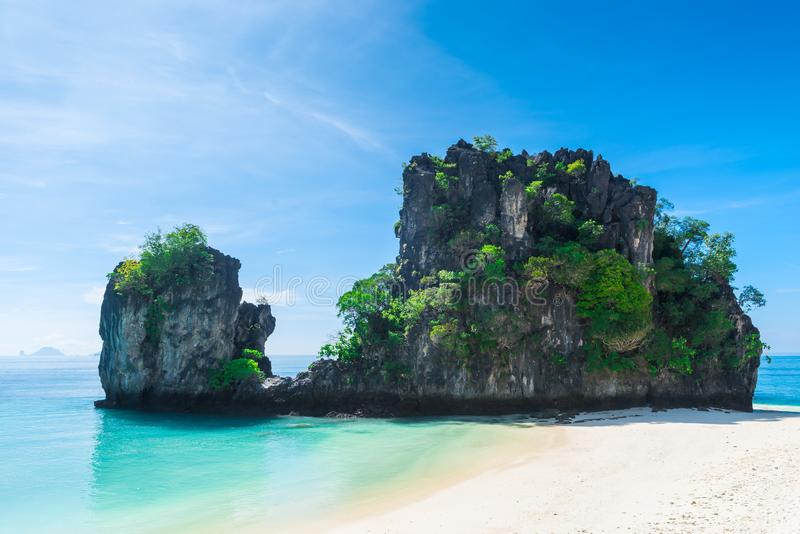 Two cliffs in the Andaman Sea near the beach of the island of Ho. Ng, Thailand royalty free stock photos