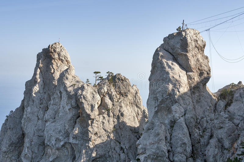 Two cliffs and ropes for extreme climbing. Two cliffs and equipment for mountain climbing and rappelling fixed on the rock. Ai-Petri, Crimea, Ukraine royalty free stock images