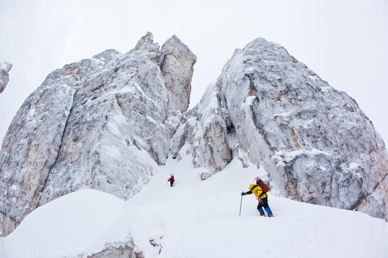 Download Two Climbers Approach To A Winter Steep Face Stock Photo - Image: 17897464