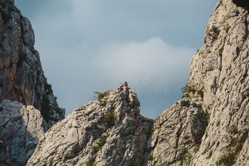 Two climbers climb to the top of the mountain royalty free stock images