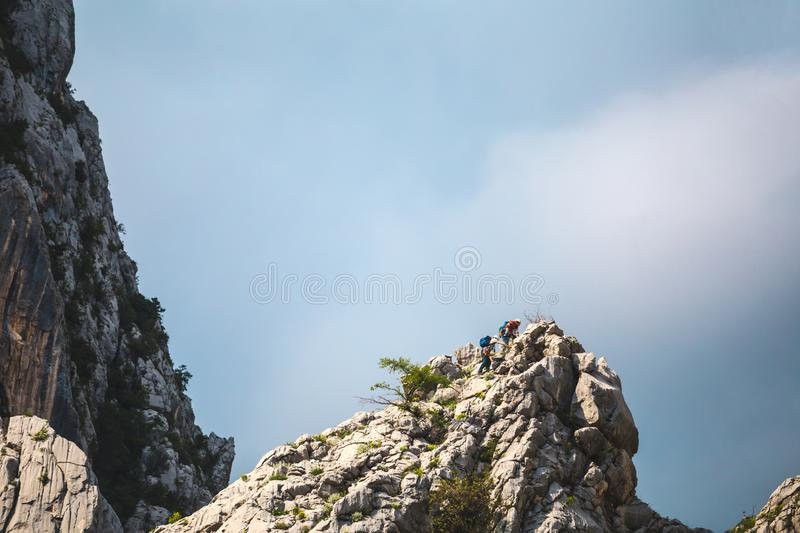 Two climbers climb to the top of the mountain royalty free stock photo