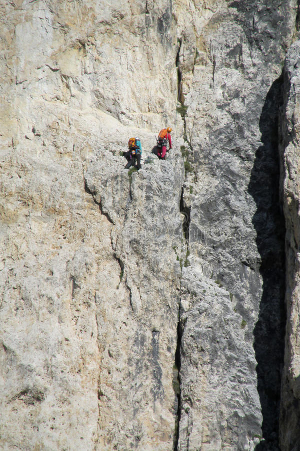 Two climbers on dangerous alpinist route royalty free stock image