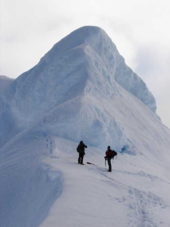 Two Climbers On Edge Of Crater Volcano Beerenberg Royalty Free Stock Photo