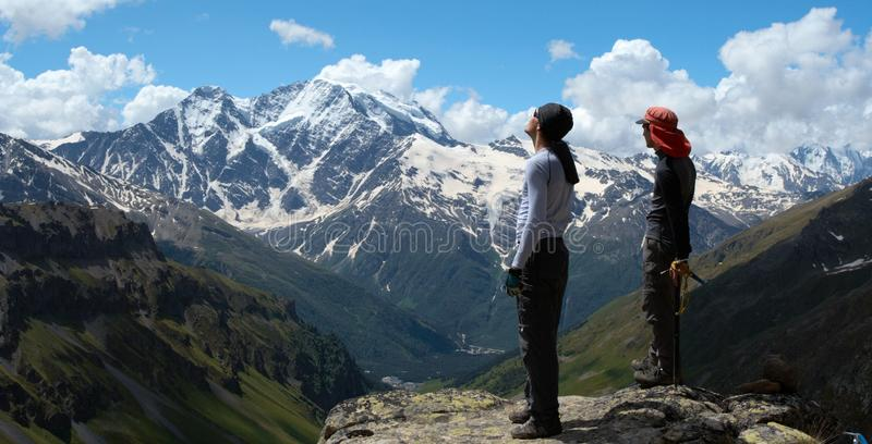 Two Climbers Looking At The Mountains Stock Images