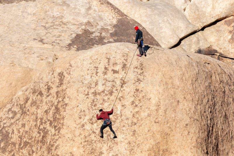 Rock climbers at Joshua Tree National Park in Southern California stock photo