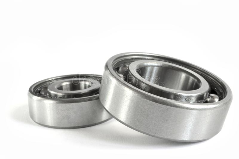 Two close-up bearings. On the white background royalty free stock images