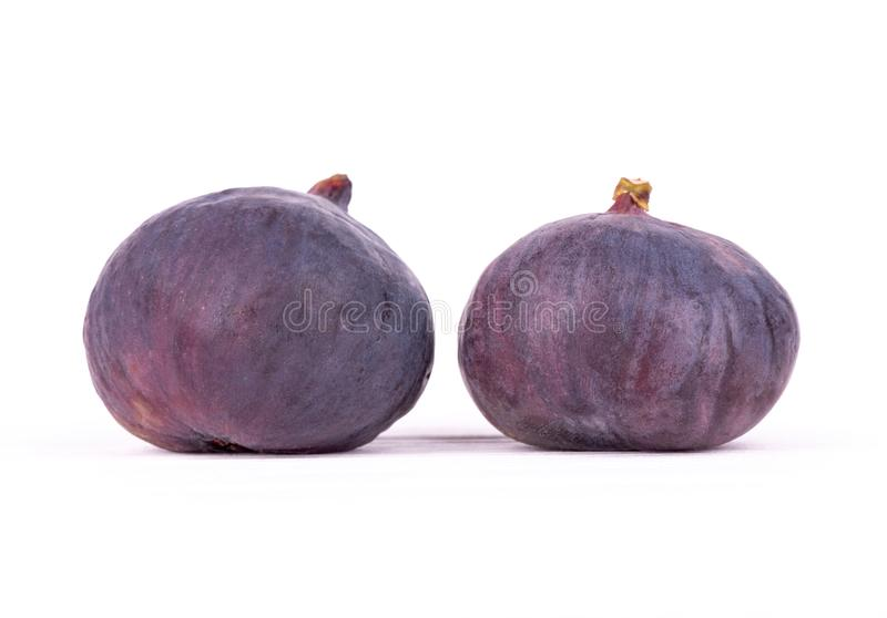 Two close-up figs on white wooden table royalty free stock image