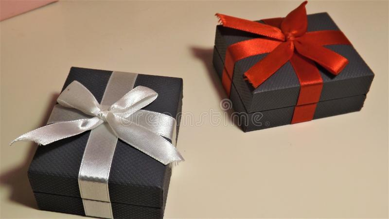 Closed Ring Boxes With Red And White Ribbons stock photos